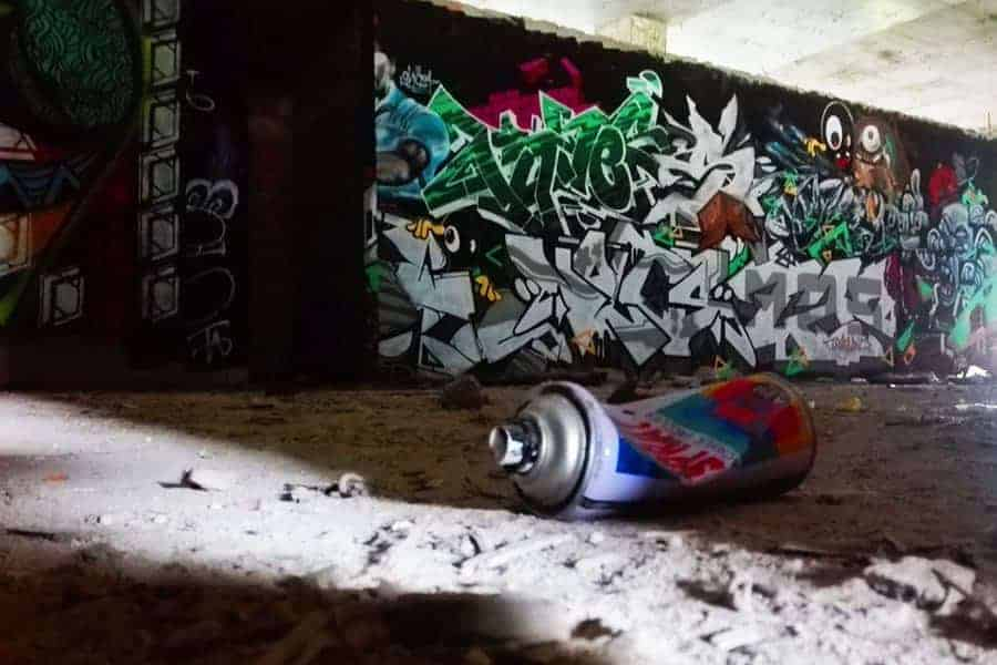 Spray-Can-and-grafitti-in-abandoned-building-off-main-road-near-Chiang-Mai-Thailand