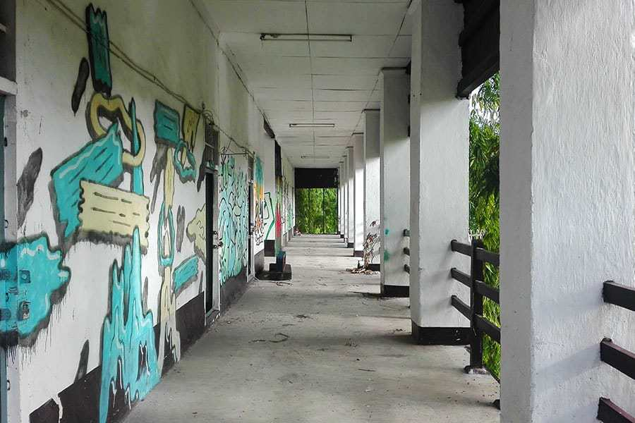 Graffiti-on-the-walls-of-the-corridor-in-the-biggest-cell-block-at-Chiang-Mai's-derelict-women's-prison-other-side
