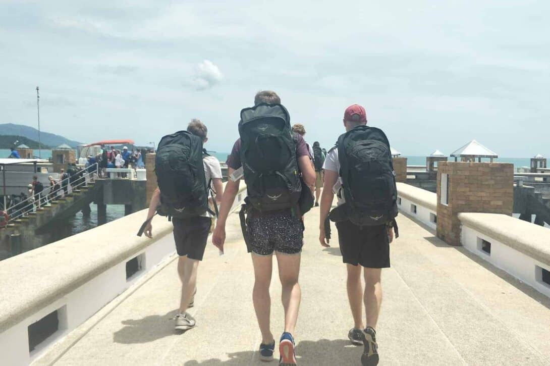 Three backpackers with their matching Osprey Backpacks heading to the Full Moon Party in Koh Phangan!