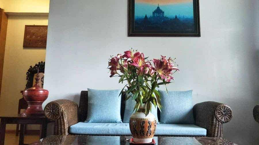 Flowers in a vase on a table by a sofa, Ma Ma Guesthouse, Mandalay