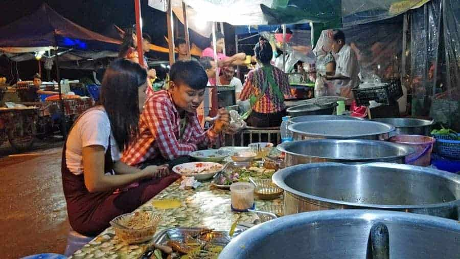 A couple eat at the night market in Hpa An.