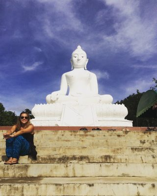 A backpacker in Pai at a Buddha Statue
