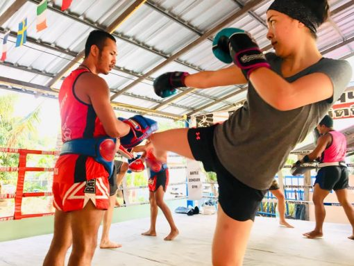 A Girl Practises Her Kick at Battle Conquer Muay Thai Gym
