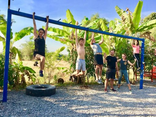 A Group Hangs From The Monkey Bars at Battle Conquer Muay Thai, Petchabun