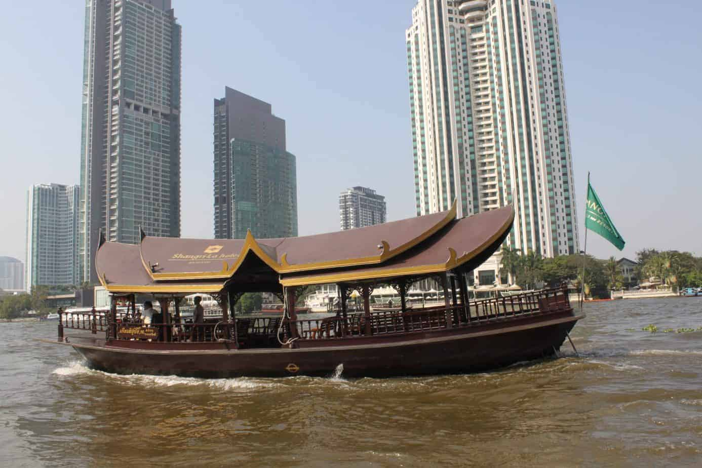 A 5-star hotel shuttle boat on the bacteriological waters.