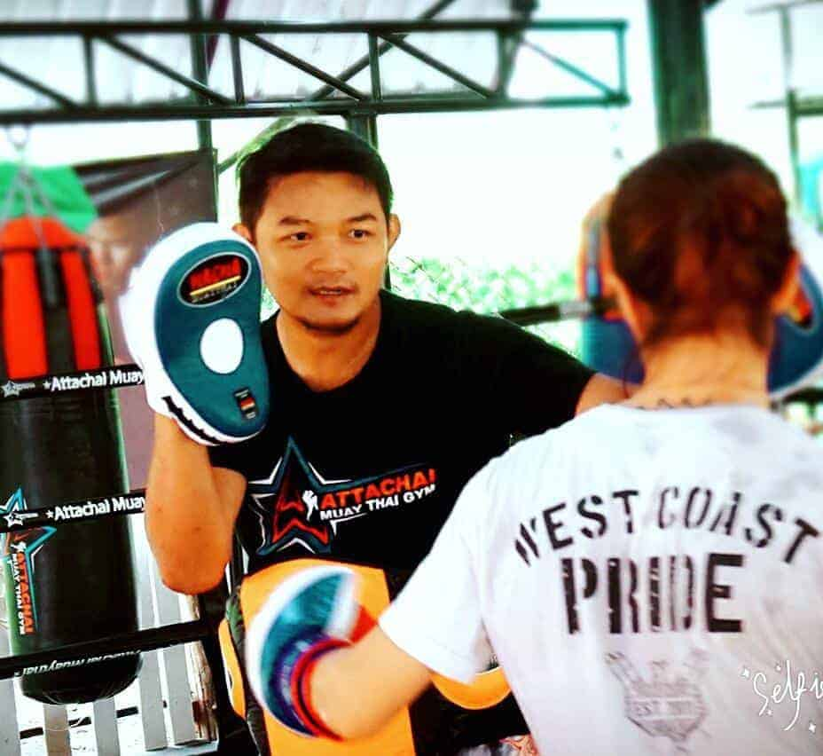 Attachai trains with a student at his gym in Bangkok.