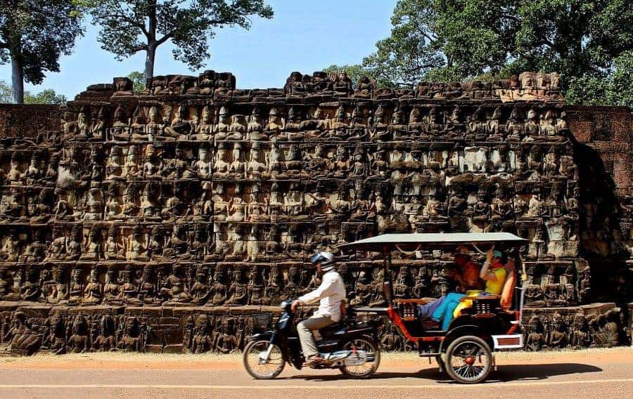 Motoring through Angkor Thom past the Terrace of the Leper King.