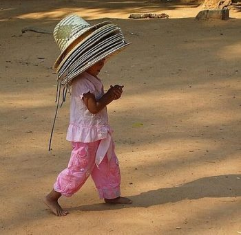 Little girl with hats in her head.