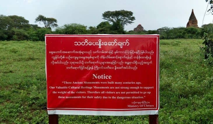 Red signs say 'no climbing' at one of the major temples in Bagan