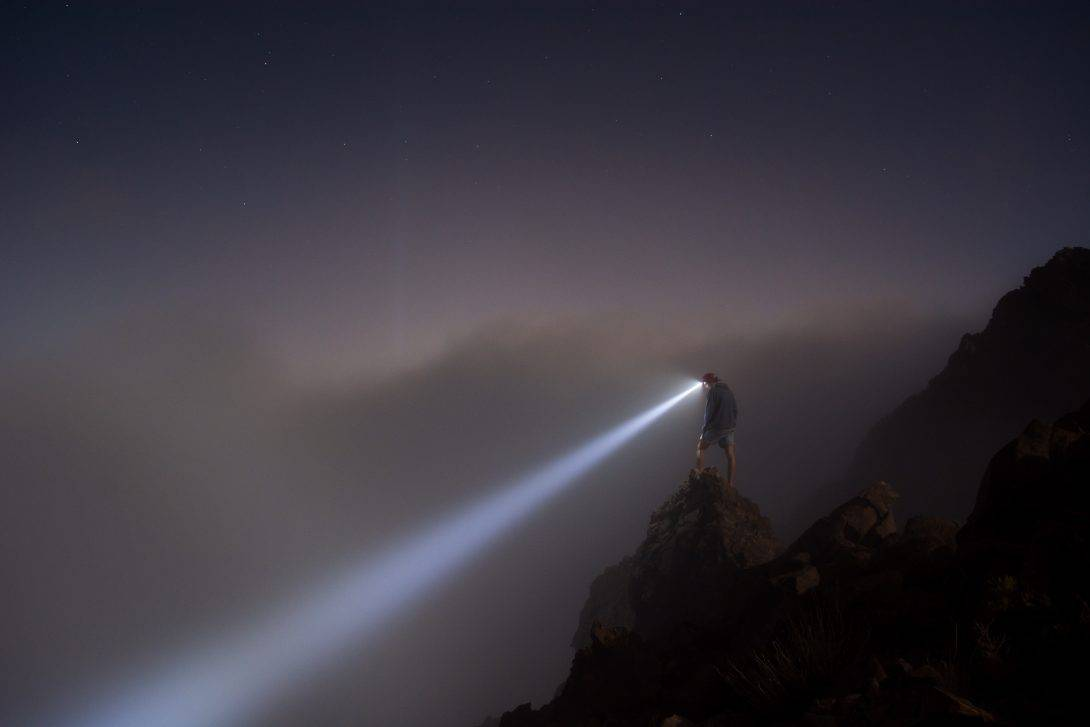 A torch beam on a misty night