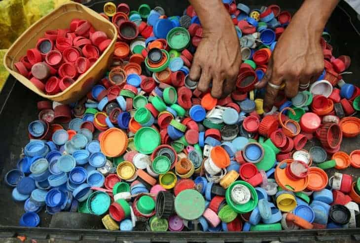 Recycling bottle tops in Thailand.