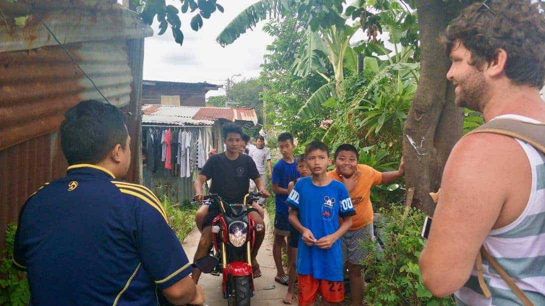 A group of local kids help us find the way to the Bangkok Train Graveyard.