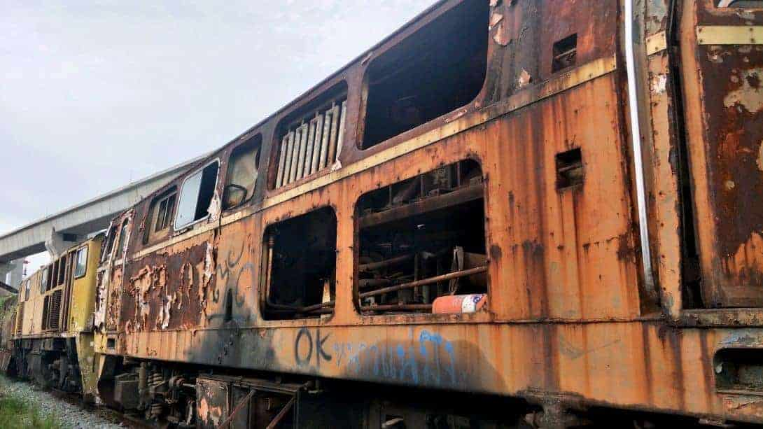 Rusted carriages with graffiti.