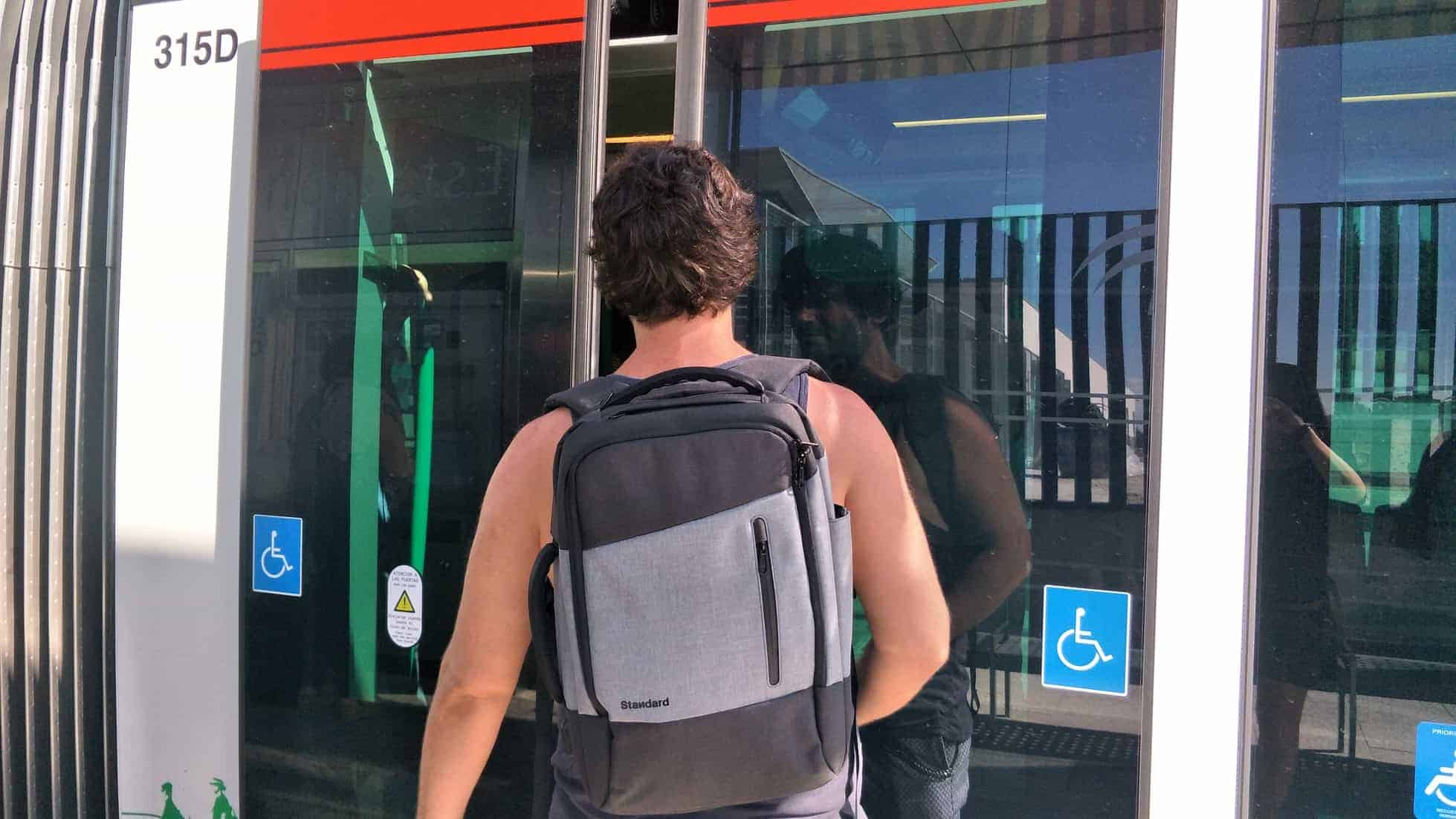 Dave gets on the metro wearing the Standard Luggage Daily Backpack