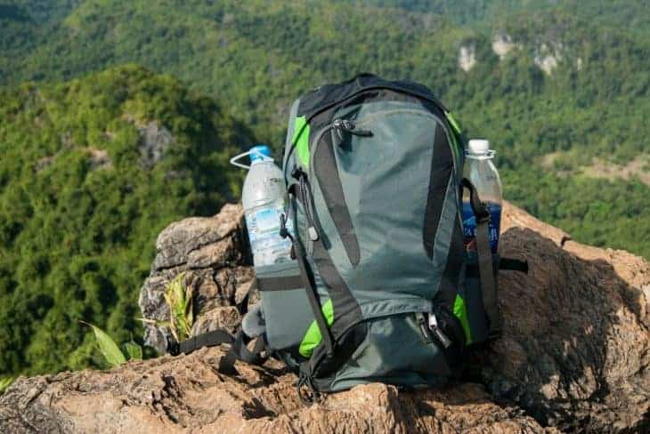 Daypack sits on mountaintop.