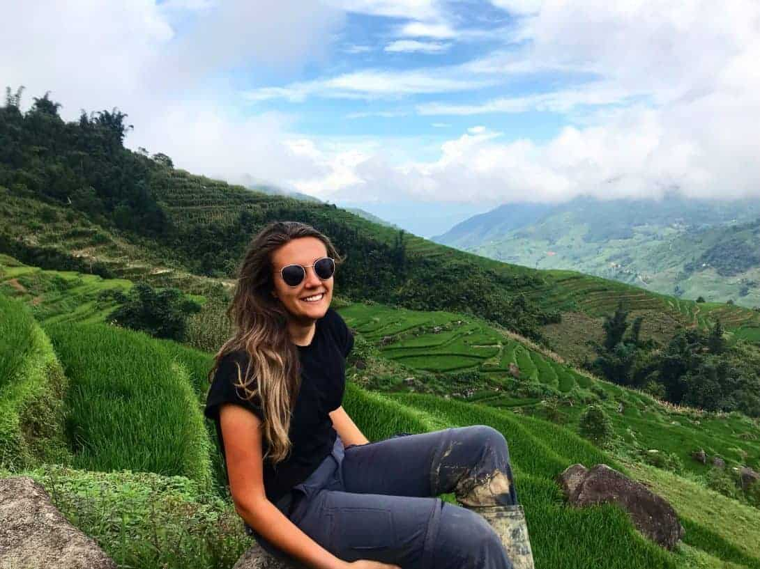 The Author Sits and Rests on a Rice Terrace During Her Sapa Trekking Tour