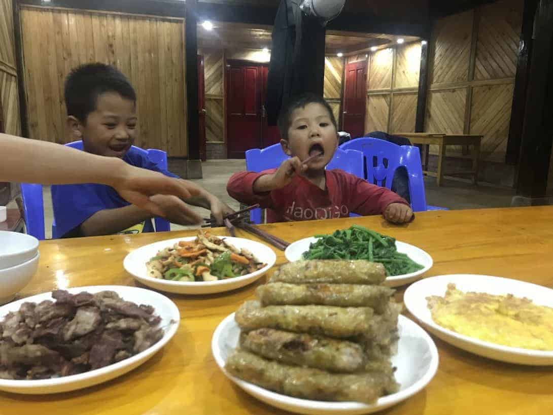 Two Children Eating At The Homestay in Sa Pa, Vietnam