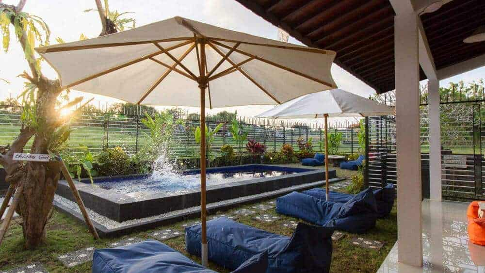 The cozy waterfront in a peaceful country setting of the pool at The Nest Hotel