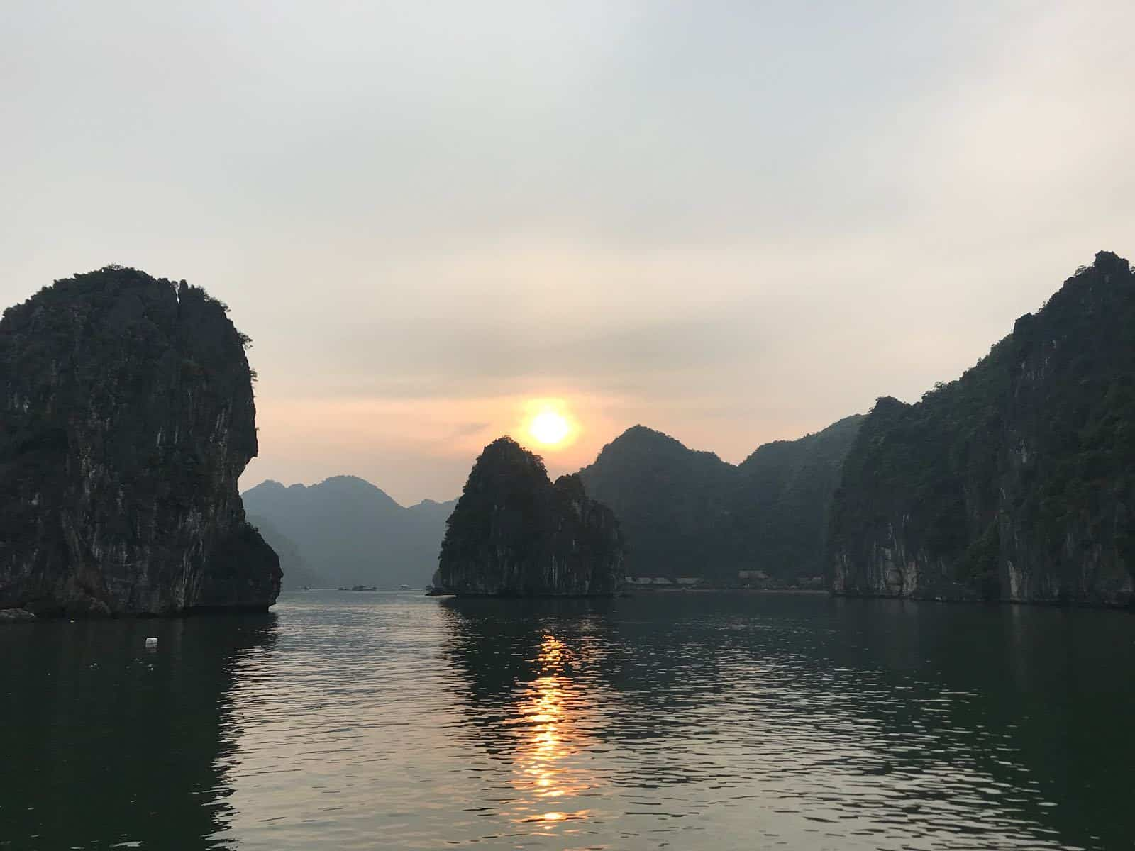 Towering cliffs adorn the water in Halong Bay, Vietnam
