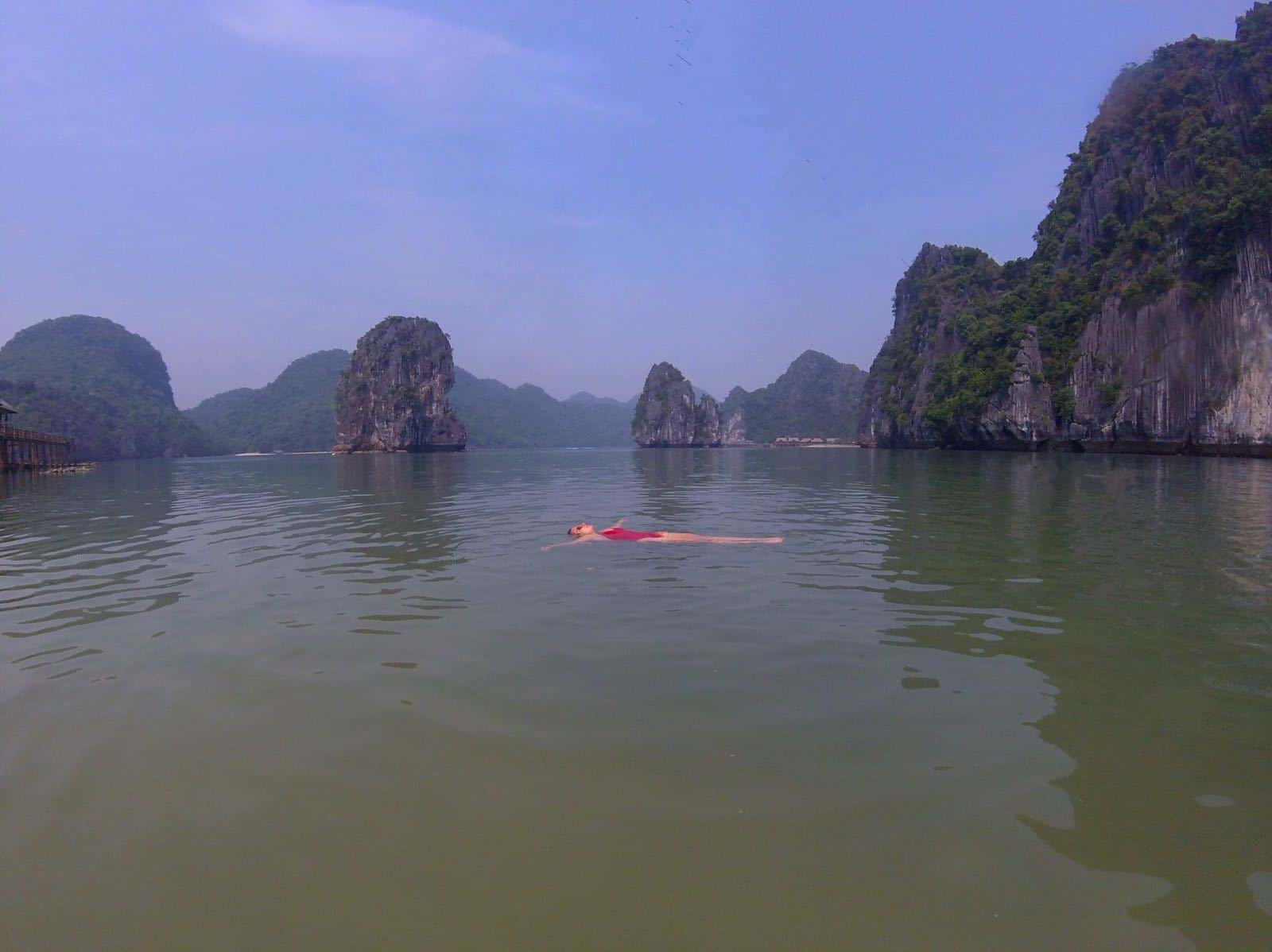Swimming in the placid water of Halong Bay, Vietnam.