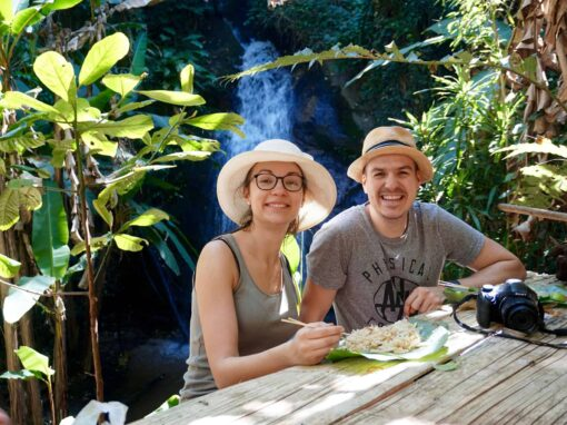 Having lunch by the waterfall in Doi Inthanon National Park, Thailand.