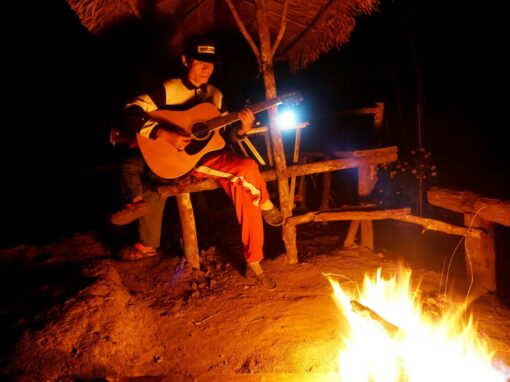 Playing guitar by the bonfire in Doi Inthanon National Park.