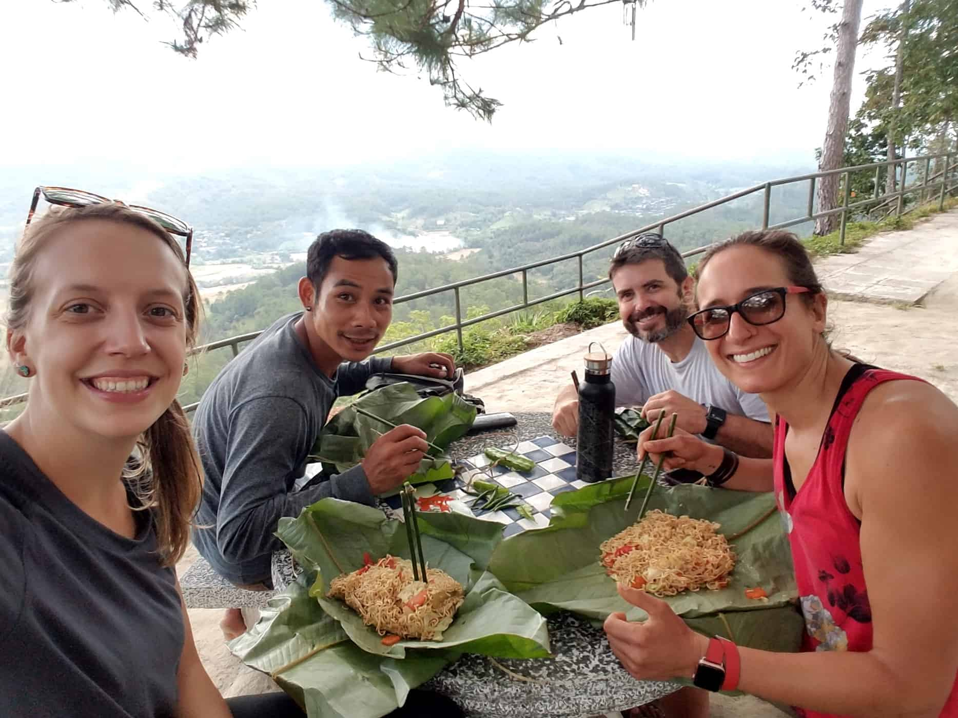 A Group of Trekkers Eat Food Wrapped in Banana Leaves in Doi Inthanon