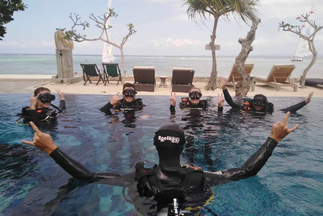 A Group of Travellers Learning to Dive in a Swimming Pool on Nusa Lembongan, Indonesia.