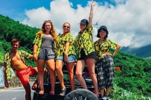 A Group Stand on the Back of a Jeep