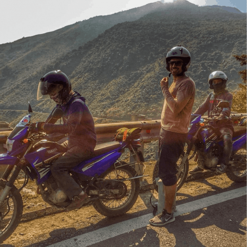 Three Boys Rest at the side of the Road on a Motorbike Ride