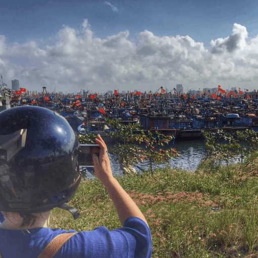 A Girl Takes a Photo of her View on The Hai Van Pass