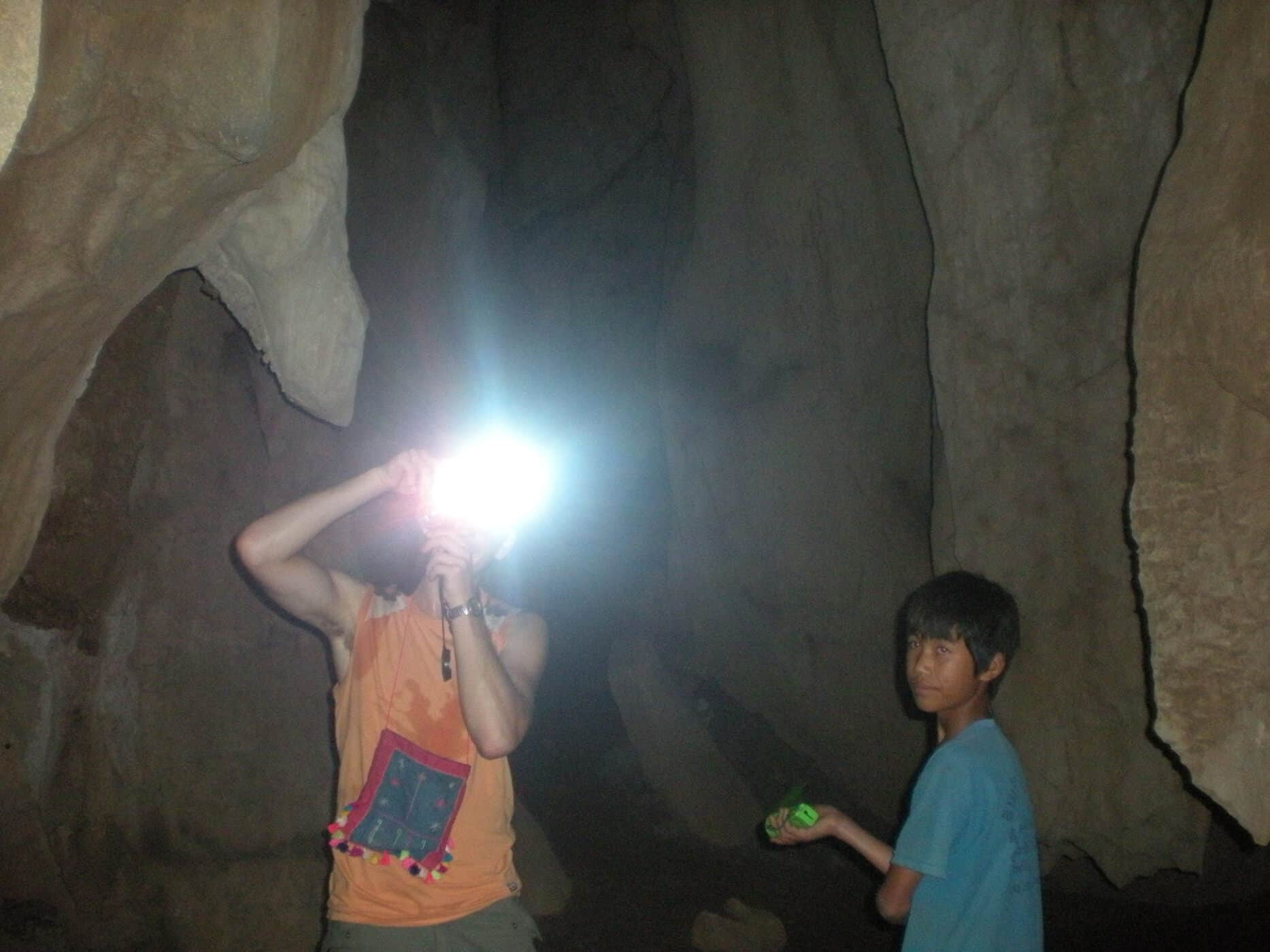 Caving with a young guide in Vang Vieng, Laos.