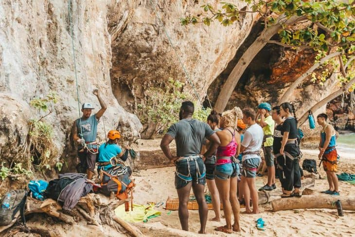 Real Rocks Guide Showing Students the Basics of Climbing