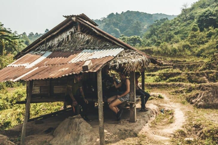 People wait in tiny hut