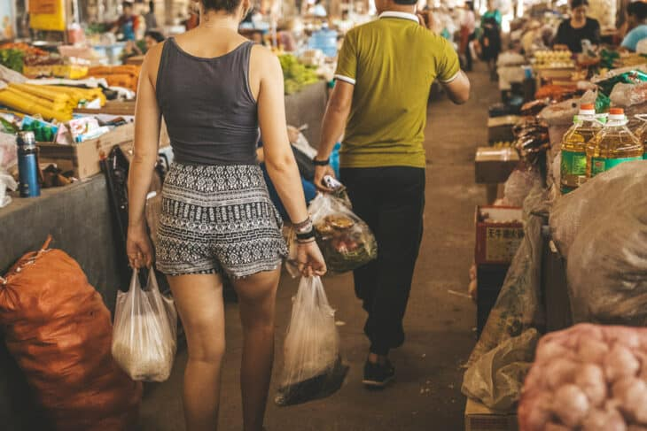 Girl carries shopping bags at market