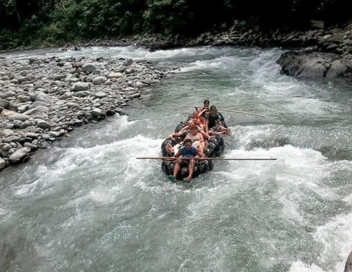 People on raft made of tyres