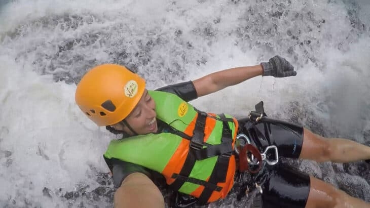 Girl jumps into whitewater during canyoning trip