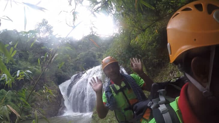 Waterfall in Dalat and man smiling in front