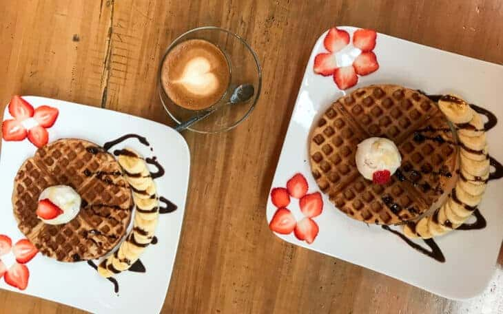Waffles with strawberries and coffee