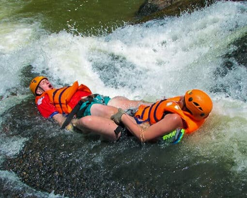 Two people water sliding
