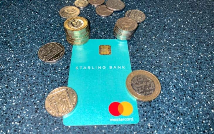 Starling card surrounded by money.