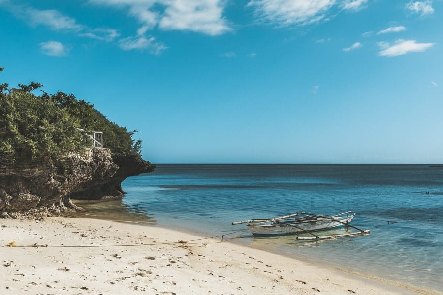 Small boat on the shoreline at a beach in the Philippines