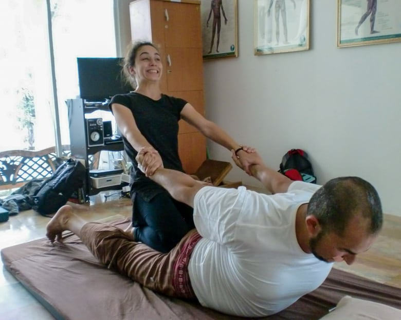 Couple stretching during Thai massage