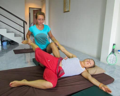 Girl stretched out whilst getting massaged