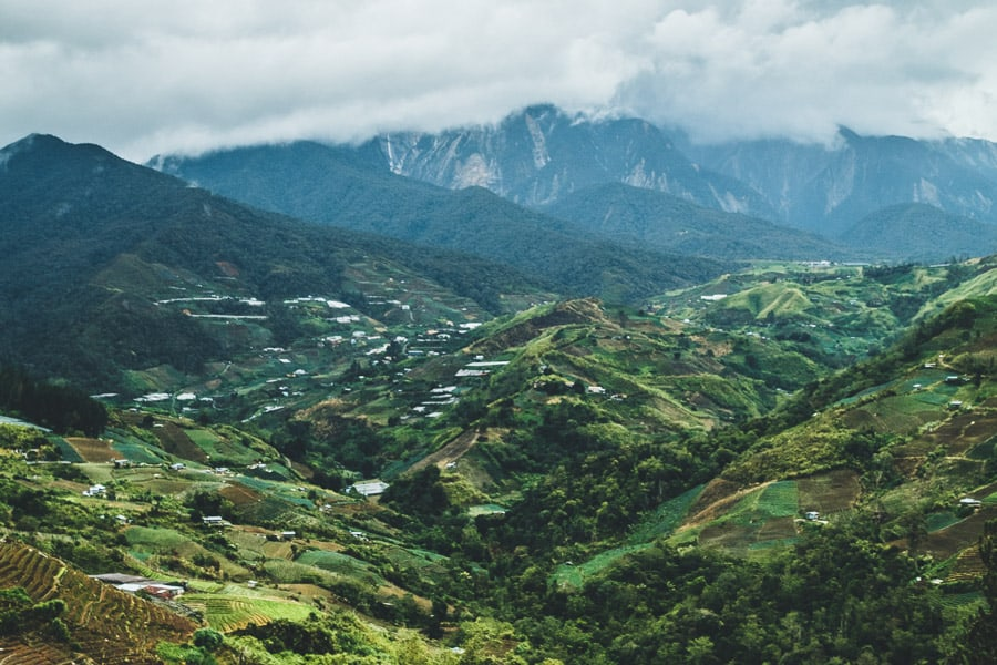 Views over the valley and mountainous landscape of Ranau, Malaysian Borneo on a cloudy day.