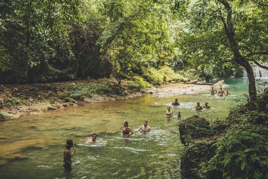 People making their way downstream as the Green Valley, Pangandaran, Indonesia