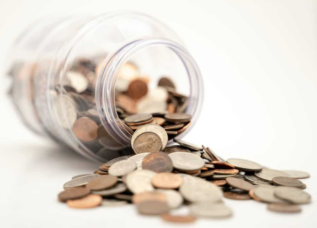 Coins spilling from a jar