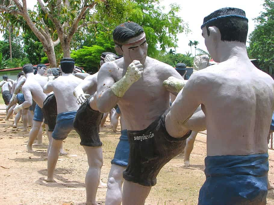 Muay Thai statues at Wat Khai Bang Kung show all of the different Muay Thai fighting positions.