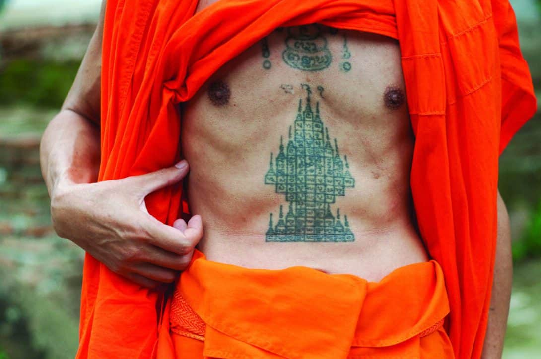 A monk with a sak yant tattoo.