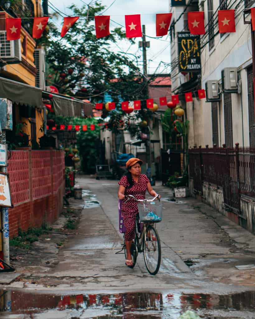 Local lady riding bike in Hoi An.